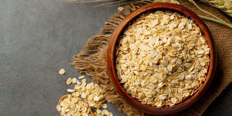 raw barley grain in old dark background